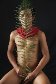 Nude Balinese guy with red cloth and green fern