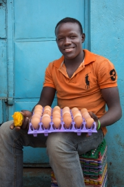 Thika market - man with eggs