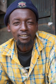 Thika market - man with mortarboard