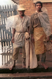 Two men in plastic wrap against the rain - Madagascar